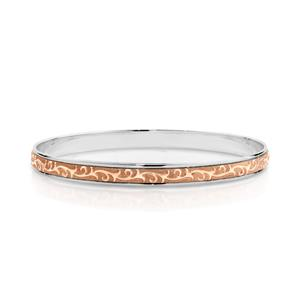 <p>Two-tone Machine Engraved Bangle. Rose gold on Sterling Silver.</p>