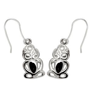 <p>Tiki earrings on card</p>