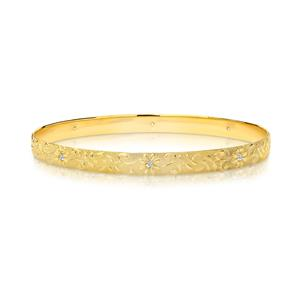 <p>Solid bangle, half round profile. Machine engraved Floral pattern with 8 x .02ct diamonds, Total diamond weight 0.16ct Approx. 1.25mm thick.</p>