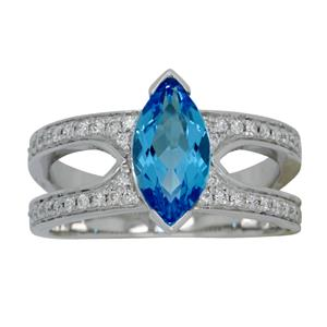 <p>Split Shank White Gold Marquise Topaz and Diamond Ring. Total Diamond Weight 0.36ct</p>